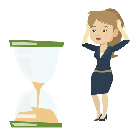 Desperate business woman looking at hourglass.