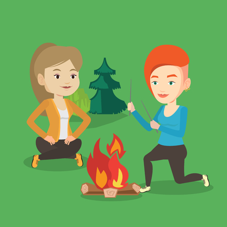 two friends: Two friends sitting around bonfire in camping.