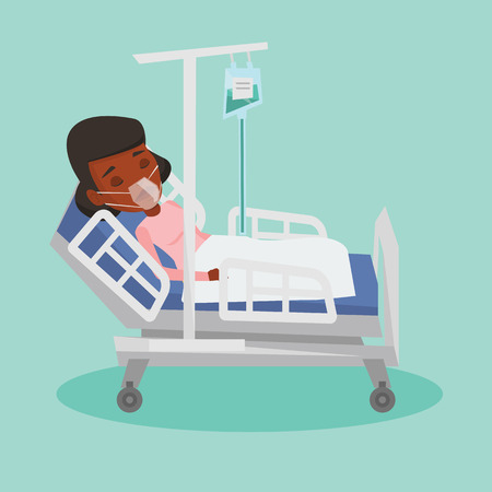 woman lying in bed: Patient lying in hospital bed with oxygen mask.