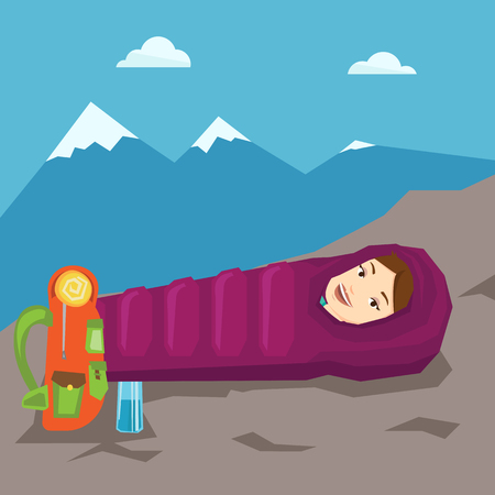 sleeping bag: Woman resting in sleeping bag in the mountains.