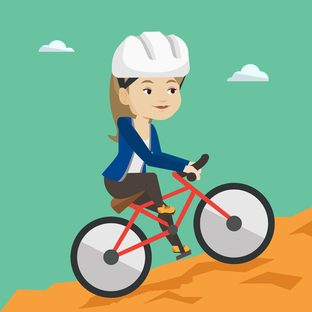 Young woman on bicycle traveling in the mountains.