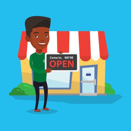 shop assistant: Shop owner holding open signboard.