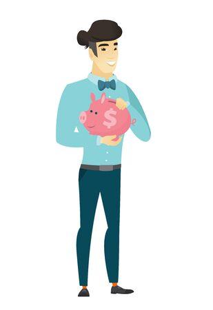 asian business: Asian business man holding a piggy bank.