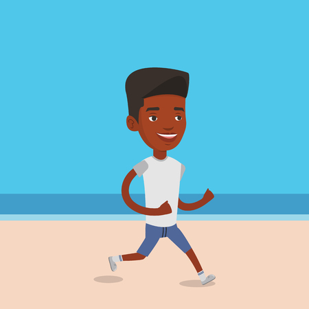 Young sporty man jogging on the beach.