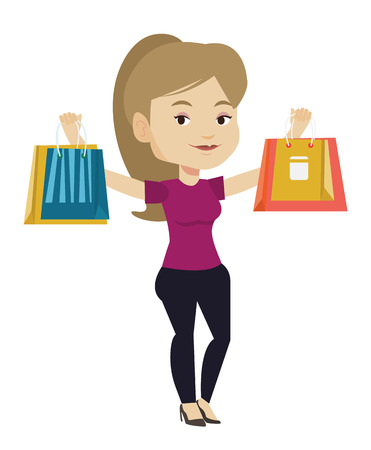 Happy woman holding shopping bags.