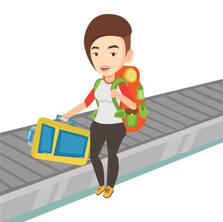 belt up: Woman picking up suitcase on luggage conveyor belt