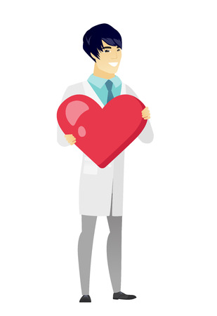white coat: Asian doctor holding a big red heart.