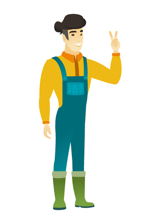 Asian farmer in coveralls showing the victory gesture. Farmer showing the victory sign with two fingers. Farmer with victory gesture. Vector flat design illustration isolated on white background.