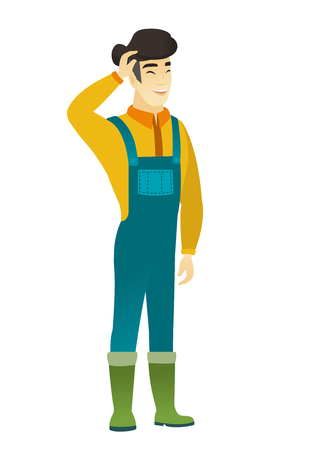 asian farmer: Young asian farmer in coveralls laughing.