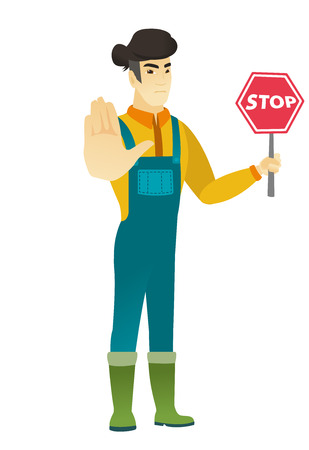 Asian farmer holding stop road sign.