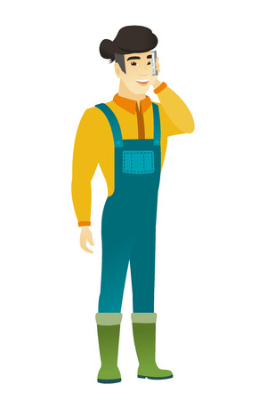 asian farmer: Happy asian farmer in coveralls talking on a mobile phone. Smiling farmer talking on a cell phone. Young farmer with a mobile phone. Vector flat design illustration isolated on white background.