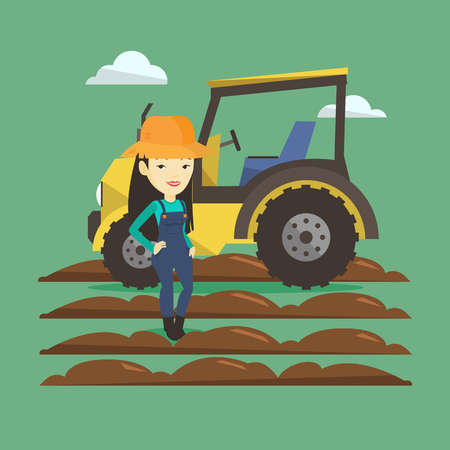 Farmer standing with tractor on background.