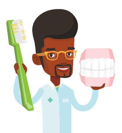 Young african-american dentist holding dental jaw model and toothbrush in hands. Friendly dentist showing dental jaw model and toothbrush. Vector flat design illustration isolated on white background. Illusztráció