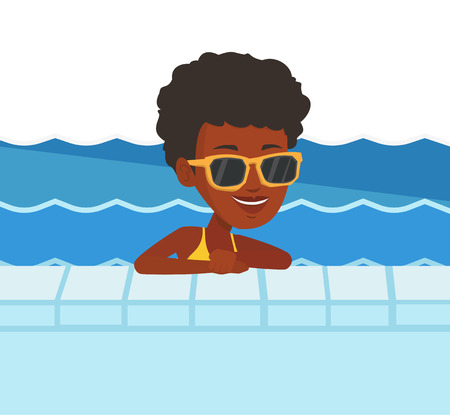 swimming glasses: Smiling young woman in swimming pool.