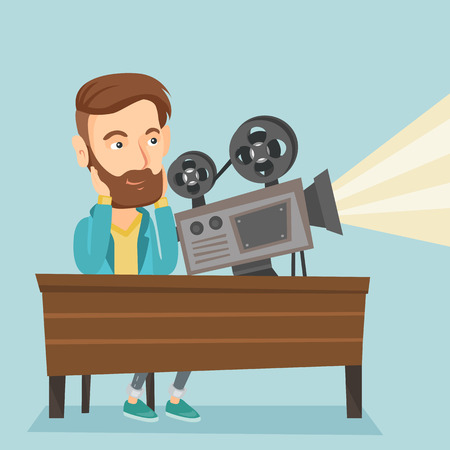 thoughtful: Caucasian projectionist showing new film. Hipster man sitting at the table with film projector in the room of projectionist. Young projectionist at work. Vector flat design illustration. Square layout Illustration