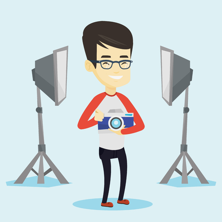 Asian photographer holding a camera in photo studio. Photographer using professional camera in the studio. Young photographer taking a photo. Vector flat design illustration. Square layout. Stok Fotoğraf - 74078071