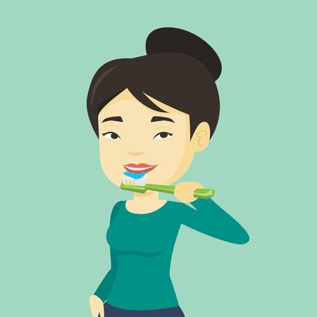 若いアジアの女性は、彼女の歯を磨きます。笑顔の女性は、彼女の歯のクリーニングします。陽気な女性は彼女の歯の世話します。手で歯ブラシを