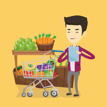 Young asian man checking shopping list. Smiling man holding shopping list near trolley with products. Happy man writing in shopping list. Vector flat design illustration. Square layout.