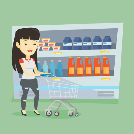 mujer en el supermercado: Asian woman walking with cart on aisle at supermarket. Young woman pushing an empty supermarket cart. Customer shopping at supermarket with cart. Vector flat design illustration. Square layout. Vectores