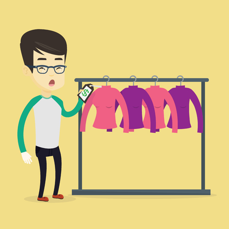 clothing rack: Surprised asian man looking at price tag in clothing store. Young shopping man shocked by price tag in clothing store. Amazed man staring at price tag. Vector flat design illustration. Square layout. Illustration