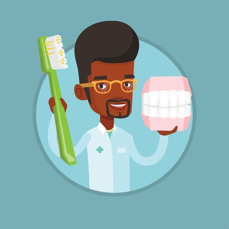 Dentiste avec modèle dentaire dentaire et brosse à dents. Banque d'images - 74690289