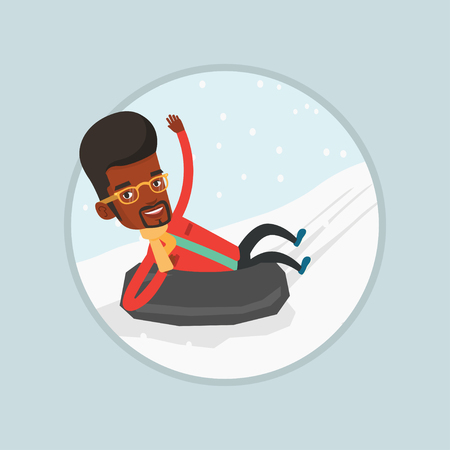 Young African man having fun while sledding on snow rubber tube. Man riding on snow rubber tube. Vectores