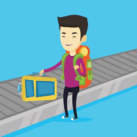belt up: Man picking up suitcase on luggage conveyor belt