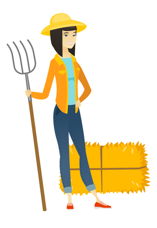 Young asian farmer holding a pitchfork.
