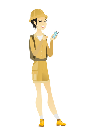 Young asian traveler holding mobile phone and pointing at it. Full length of traveler with mobile phone. Traveler using mobile phone. Vector flat design illustration isolated on white background. Illustration