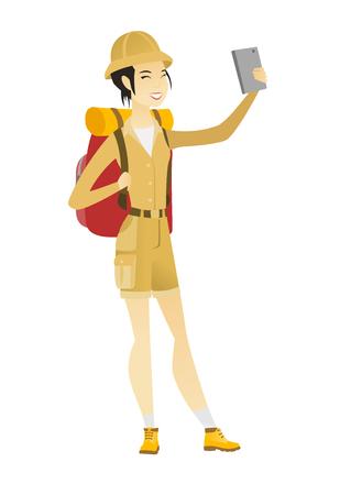 Traveler woman with backpack making selfie.