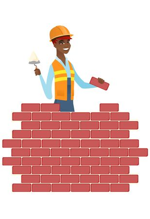African bricklayer in uniform and hard hat. Bicklayer working with spatula.