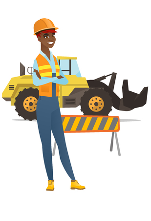 African-american confident builder standing on the background of excavator and road barrier.