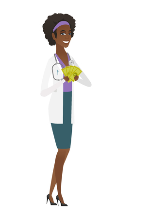 Happy african-american doctor in medical gown holding money. Excited doctor standing with money in hands.