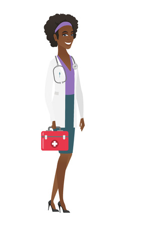 African-american doctor in medical gown holding first aid box. Friendly doctor standing with first aid kit. Doctor carrying first aid box. Vector flat design illustration isolated on white background. Vettoriali