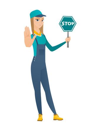 Caucasian mechanic showing stop road sign. Full length of young mechanic holding stop road sign. Serious mechanic with stop road sign. Vector flat design illustration isolated on white background. Stock Illustratie