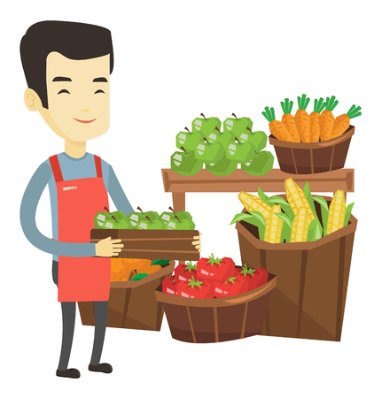 Asian worker of grocery store standing in front of section with vegetables and fruits. Worker of grocery store holding a box with apples. Vector flat design illustration isolated on white background.
