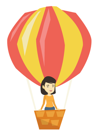 Asian woman flying in hot air balloon.