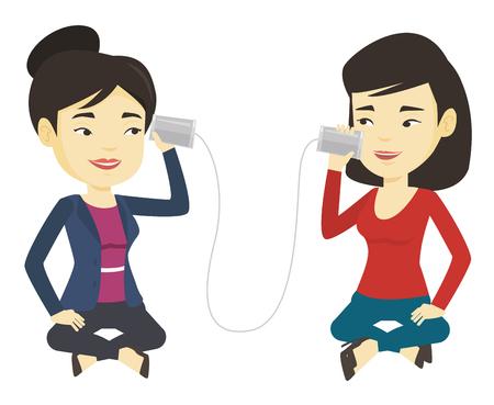 tin can phone: Young friends talking through tin phone.