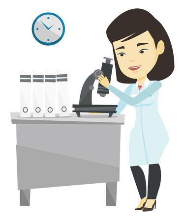 Assistente di laboratorio con il microscopio. Archivio Fotografico - 76268444