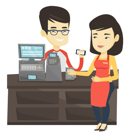 mujer en el supermercado: Customer paying wireless with smartphone.