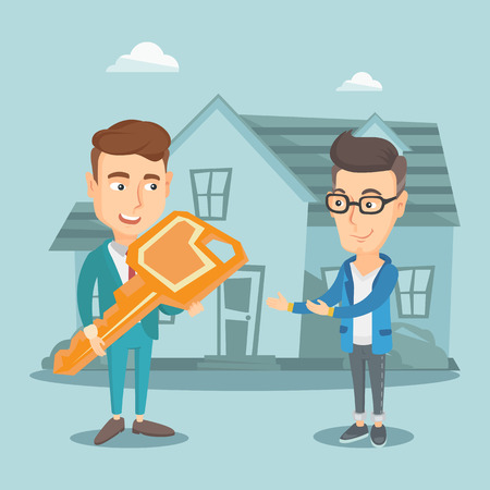 Real estate agent giving key to new house owner.