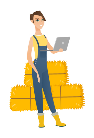 Caucasian farmer using a laptop on the background of hay bales. Full length of young farmer working on a laptop. Farmer holding a laptop. Vector flat design illustration isolated on white background.