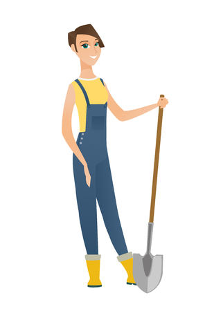 Friendly female caucasian farmer standing with shovel. Full length of young farmer in overalls holding a shovel. Gardener with a spade. Vector flat design illustration isolated on white background. Illustration