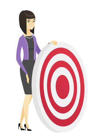 dart board: Young business woman and dart board.