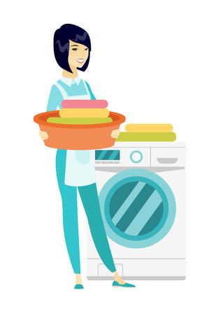 Housewife using washing machine at laundry.
