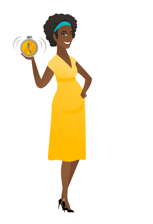 African pregnant woman holding alarm clock.