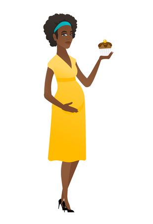 abdomen women: Pregnant woman holding a cupcake.