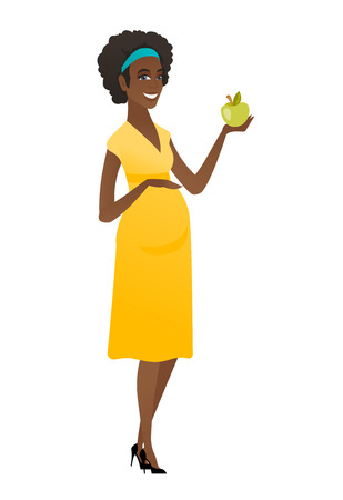 African-american pregnant woman holding apple.