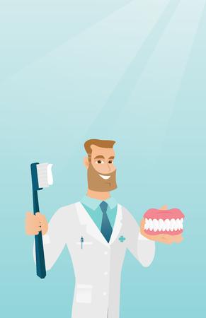 Dentiste avec un modèle de mâchoire dentaire et une brosse à dents. Banque d'images - 80040269