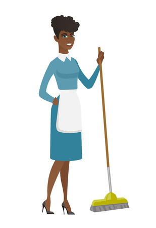 Young housemaid sweeping floor with a broom.